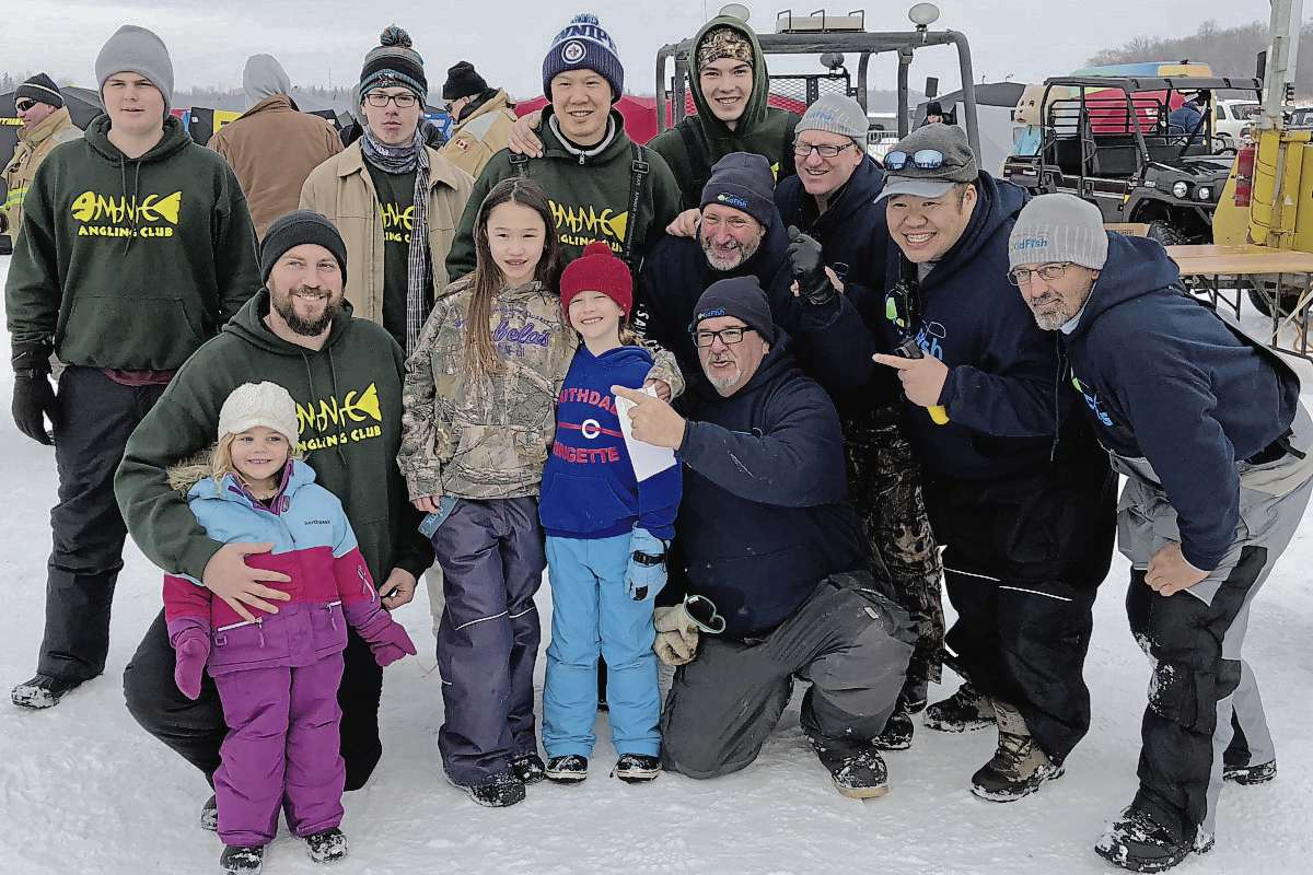 Members of Miles Macdonell Collegiate's Angling Club are pictured with participants from the annual Kid Fish Ice Derby. Back row, left to right: Ethan Ott (MMC), Liam Eori (MMC), Tim Au (Teacher MMC), and Josh Porter (MMC). Front row: Ella Opalko (MMC), Matt Opalko (MMC), Avery Au (MMC) Audrey Tessier (MMC) Paul Duncan (KidFish), Jim Bais (KidFish), Brad Porath, (KidFish), Garther Cheung (KidFish), and Mike Dotolli (KidFish). (SUPPLIED/THE HERALD/CANSTAR COMMUNITY NEWS)