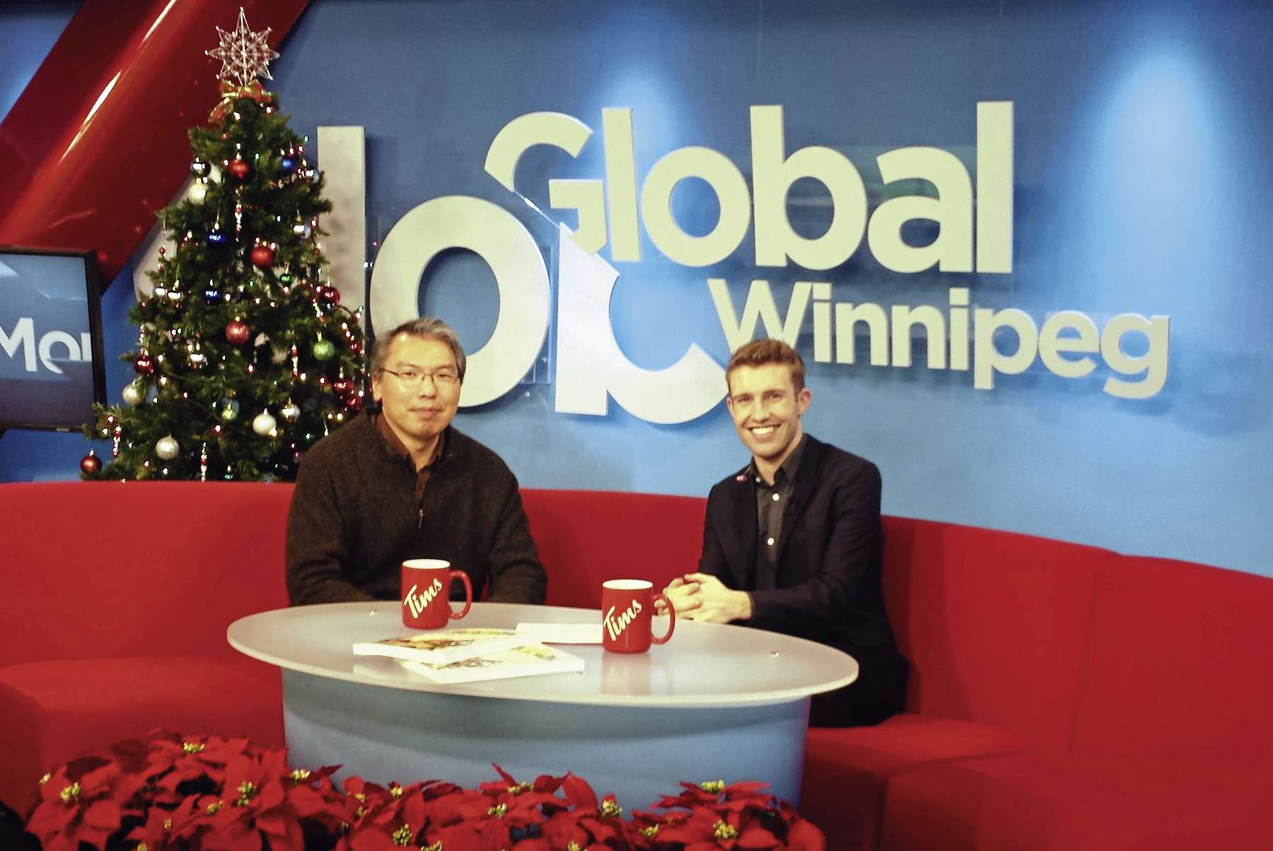 Historian and author Wayne Chan is pictured with then on-air Global host Timm Bruch.