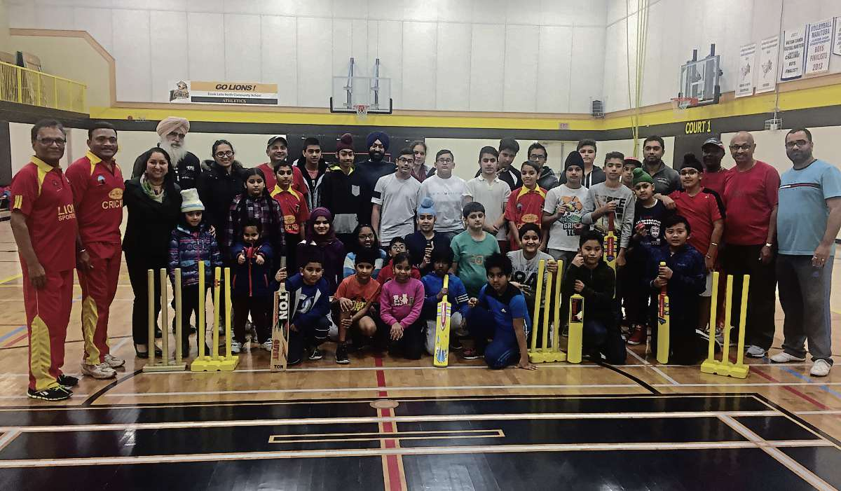 Some of the players, coaches and volunteers in the Maples C.C. developmental cricket program paused recently to pose for a photo.
