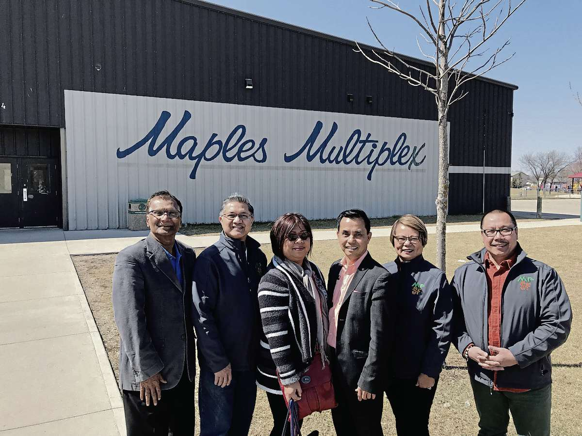After Maples Community Centre agreed to host the Manitoba Filipino Street Festival,  Maples president Derek Dabee posed with Ley Navarro, chairman of the Filipino Street Festival, and Rowena Oquendo, vice-president, and directors Orlando Sanchez and Victoria and Marc Tumolva.