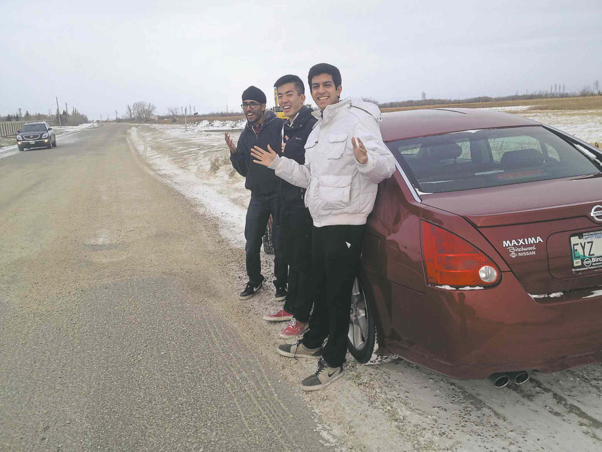 Maples Collegiate students Gurucharanpreet Buttar, Billy Hung and Jay Punj on a stretchy of dusty old Pipeline Road, which is about to get a facelift.