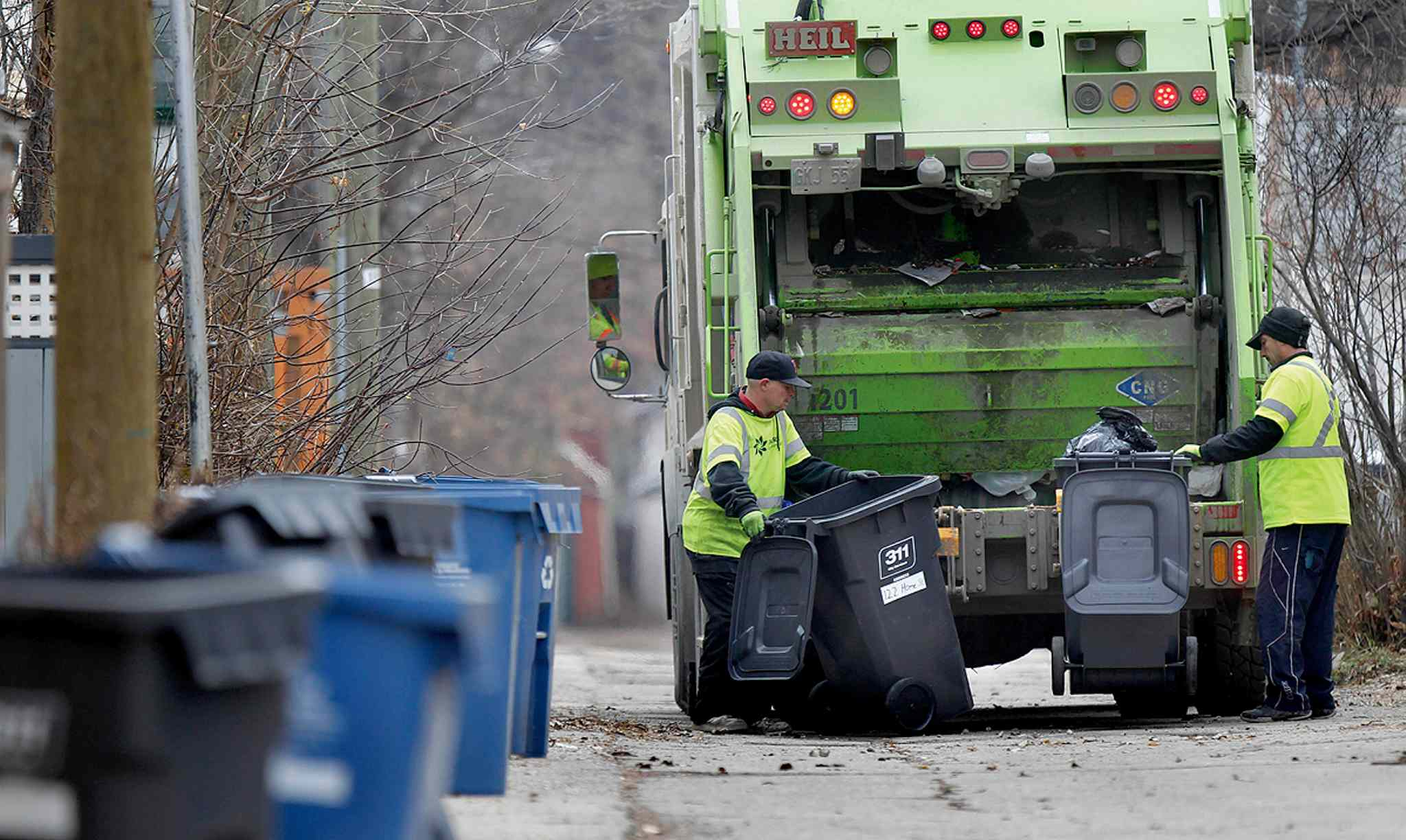 An Emterra team collects garbage in Wolseley in this 2012 file photo. Those who worked collecting garbage and recycling this past winter deserve our thanks, our columnist says.