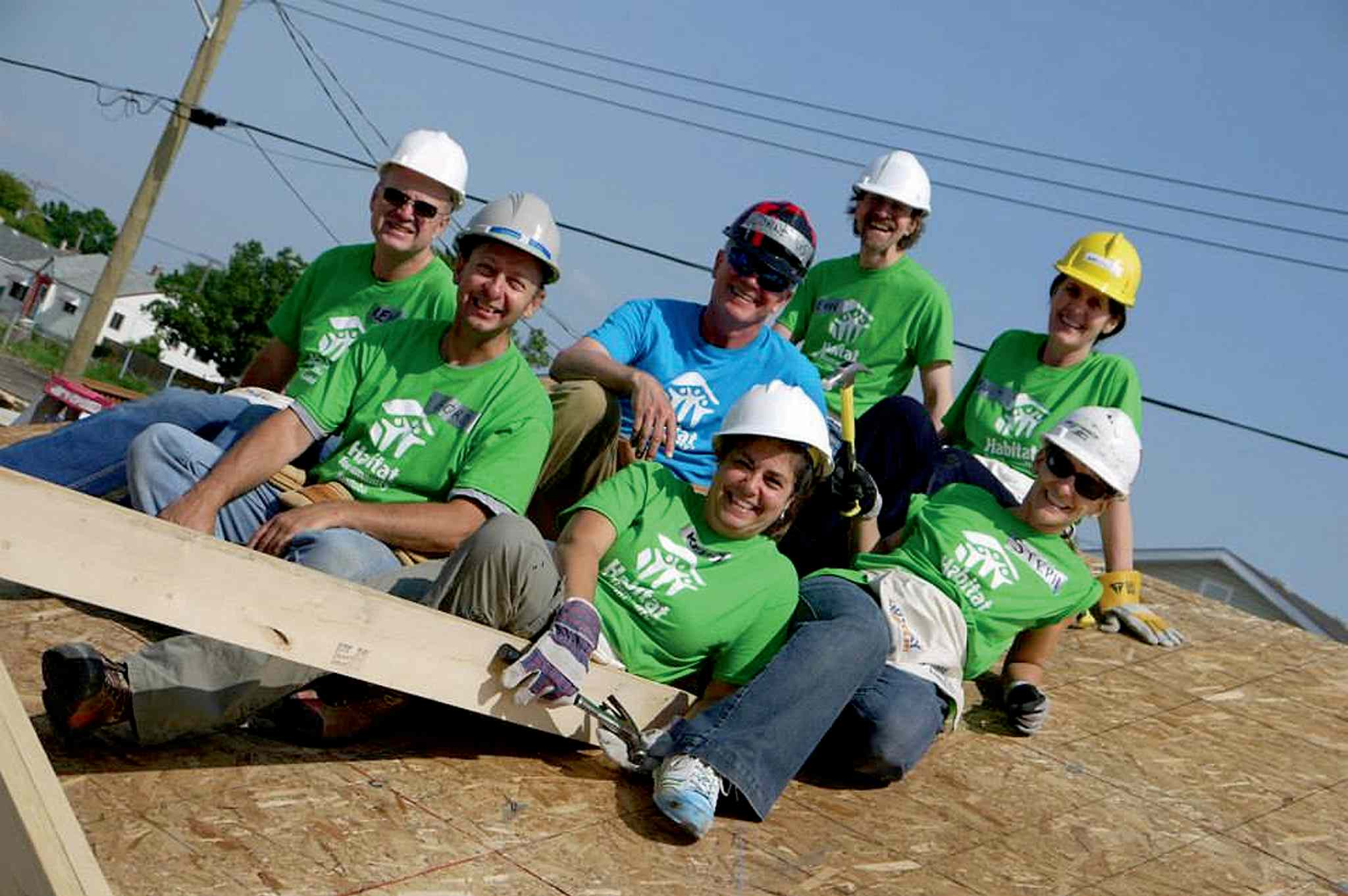 Stephanie Staples (right, white hardhat) and her Habitat for Humanity build team thoroughly enjoyed their day.