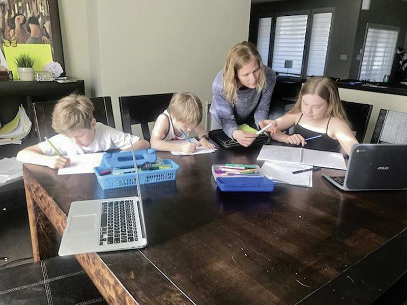 Robynn, above, coaches and teaches her children Cassie, Maddux and Theo every morning at home while Manitoba schools are shut owing to the COVID-19 pandemic.