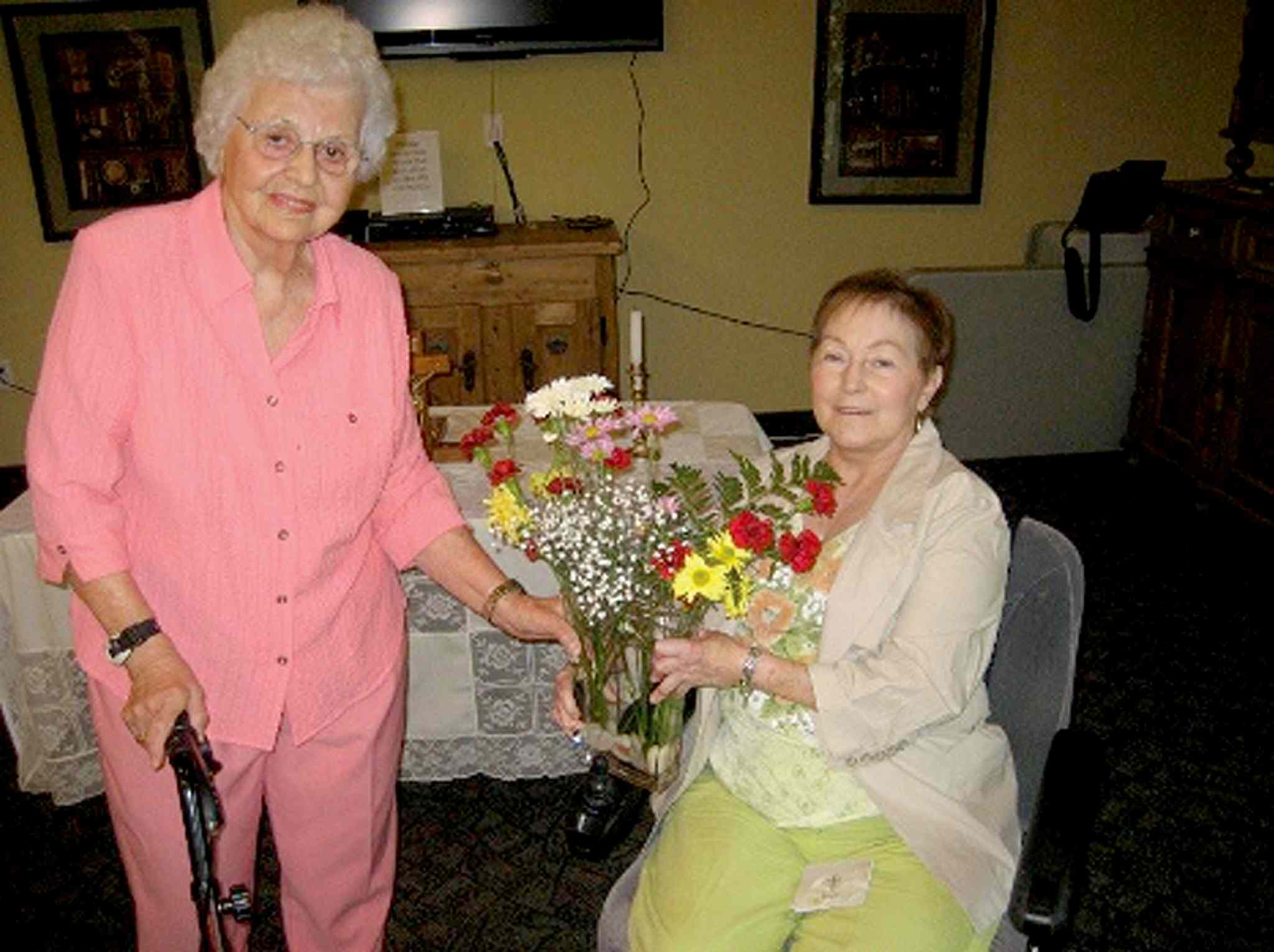 Barbara Barnard (left) presenting a bouquet to Janine Chenier on Aug. 8, 2010.