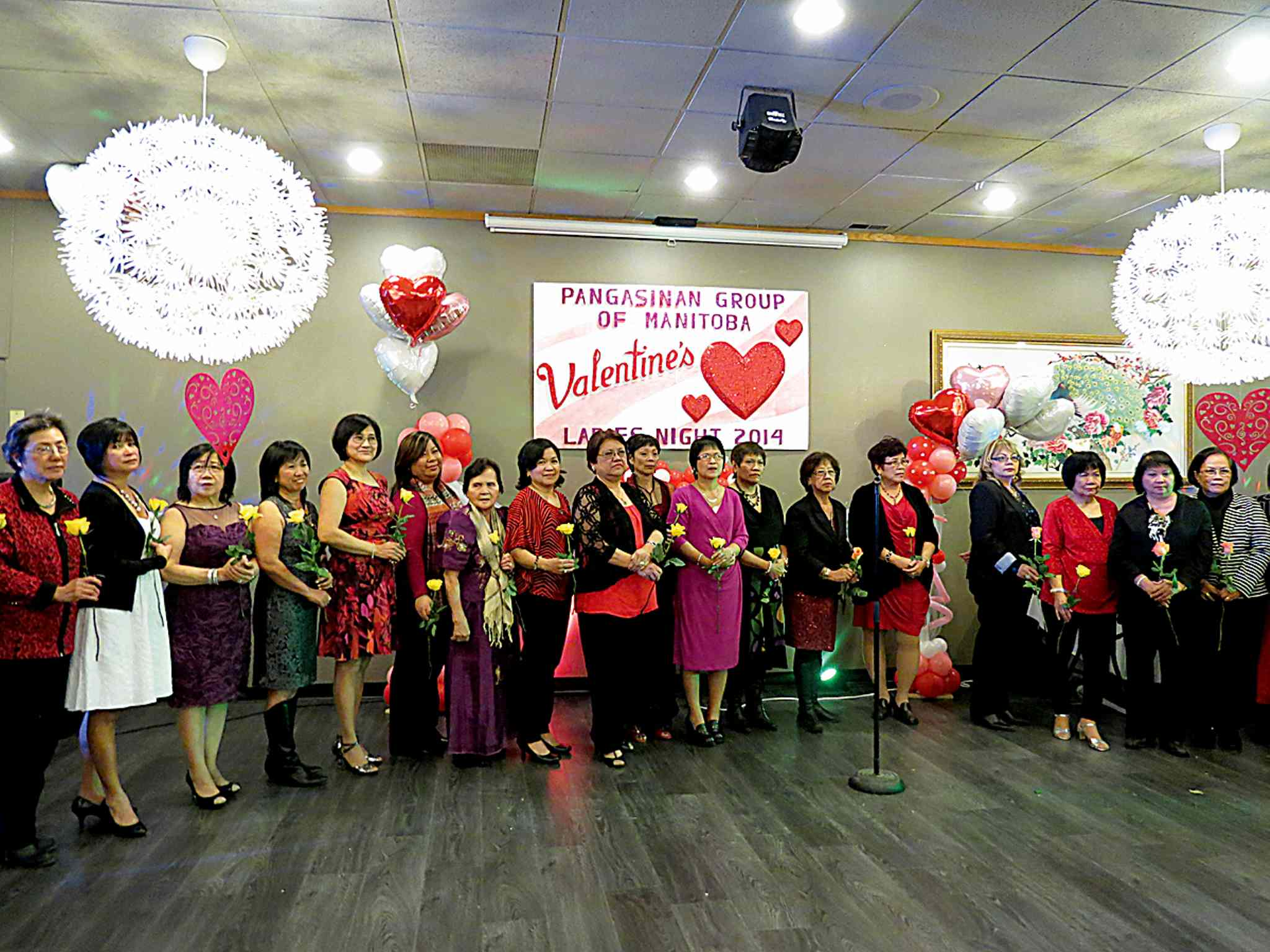 Ladies received roses from the Pangasinan Group of Manitoba during the flower presentation ceremony at the group's Valentine's Day celebration.