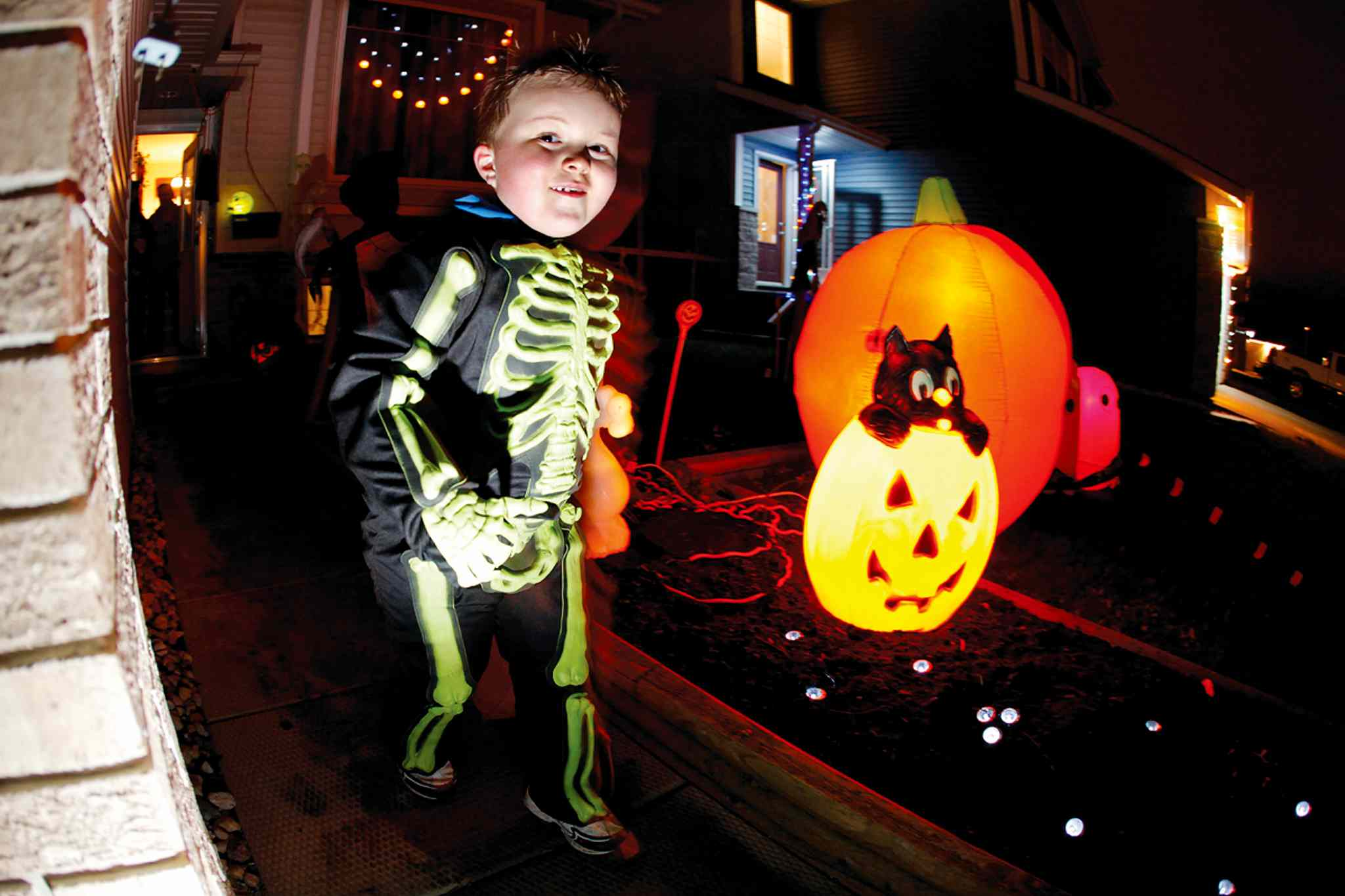 Skeleton Tanner Vandale is pictured trick-or-treating last year. Winnipeg police are urging parents to choose safe Halloween costumes this year.