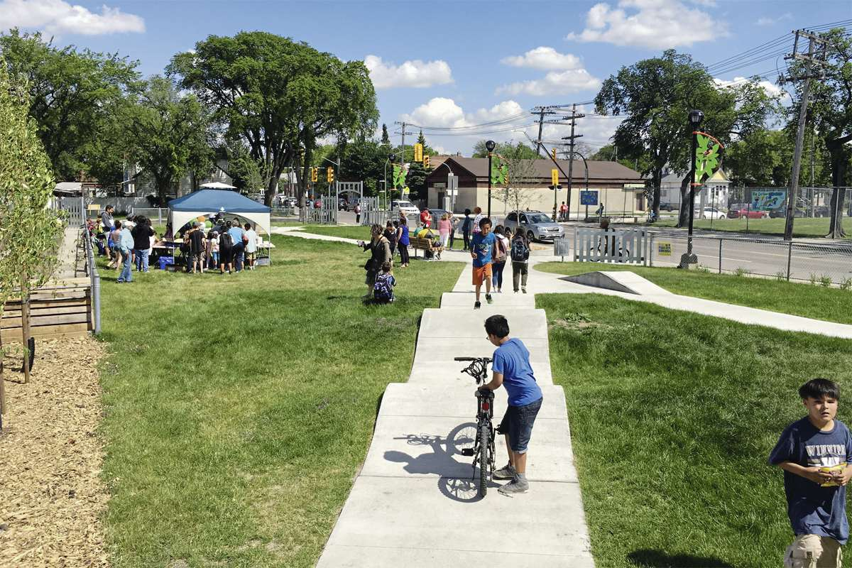 The community was recently invited to celebrate completed improvements to the Valour Community Centre Orioles site, which include new benches, community garden beds, and a bike track with unique elements.