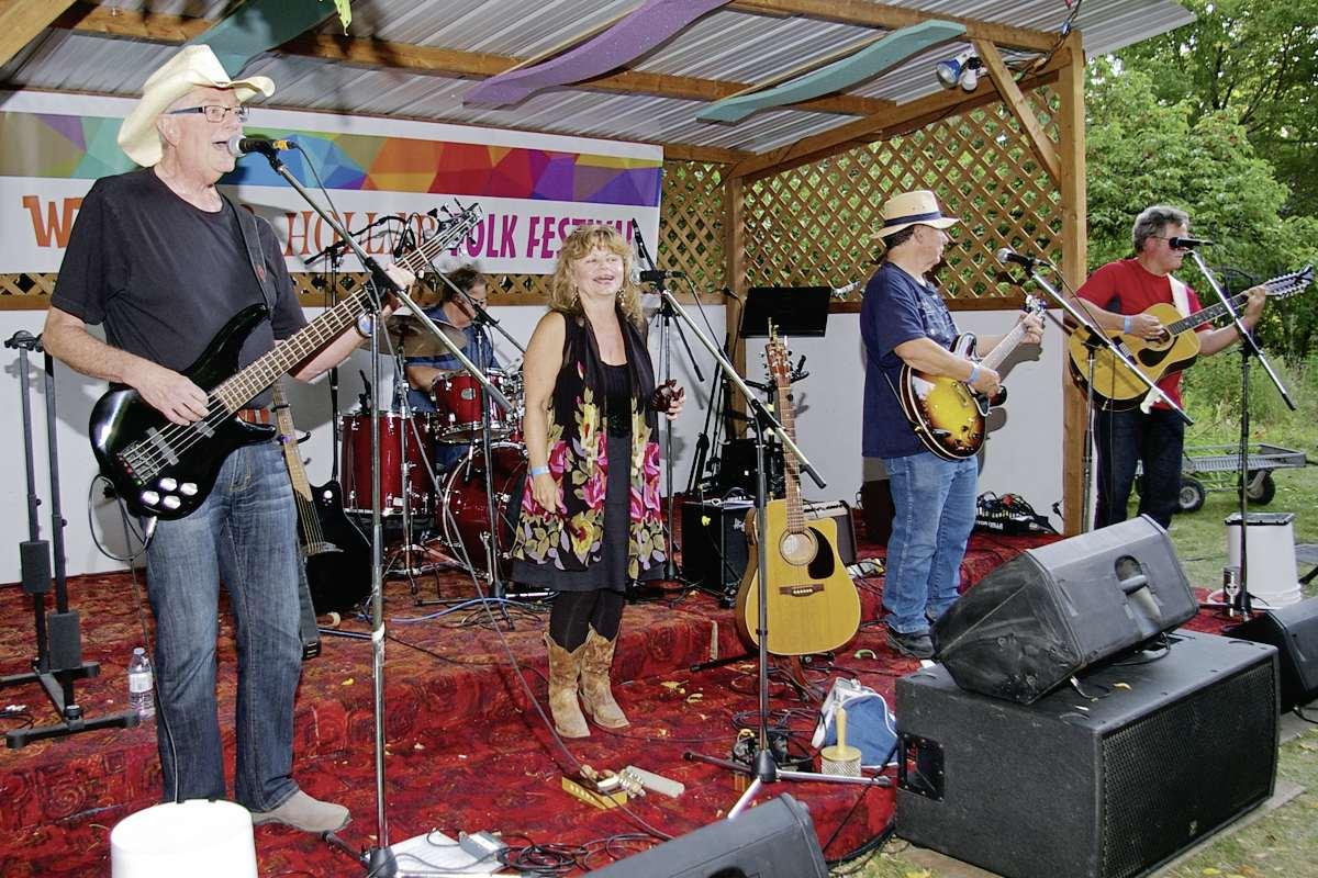 Baltimore Road delights audiences under a sweeping tree canopy at a previous Whoop & Hollar Festival. This year's festival is set for Aug. 25.