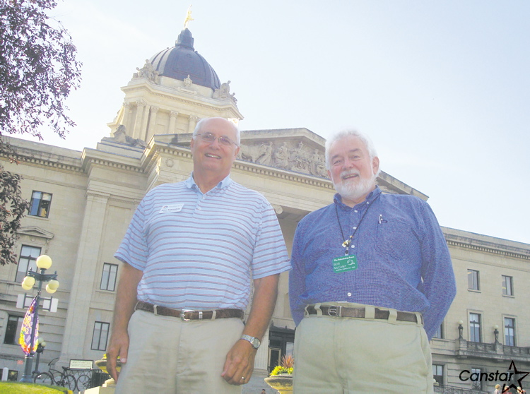 Michael Rakouskas (left) and Bob McCamy were among 16 North Carolinians visiting the Manitoba legislature as part of a Friendship Force home-stay visit in Winnipeg.