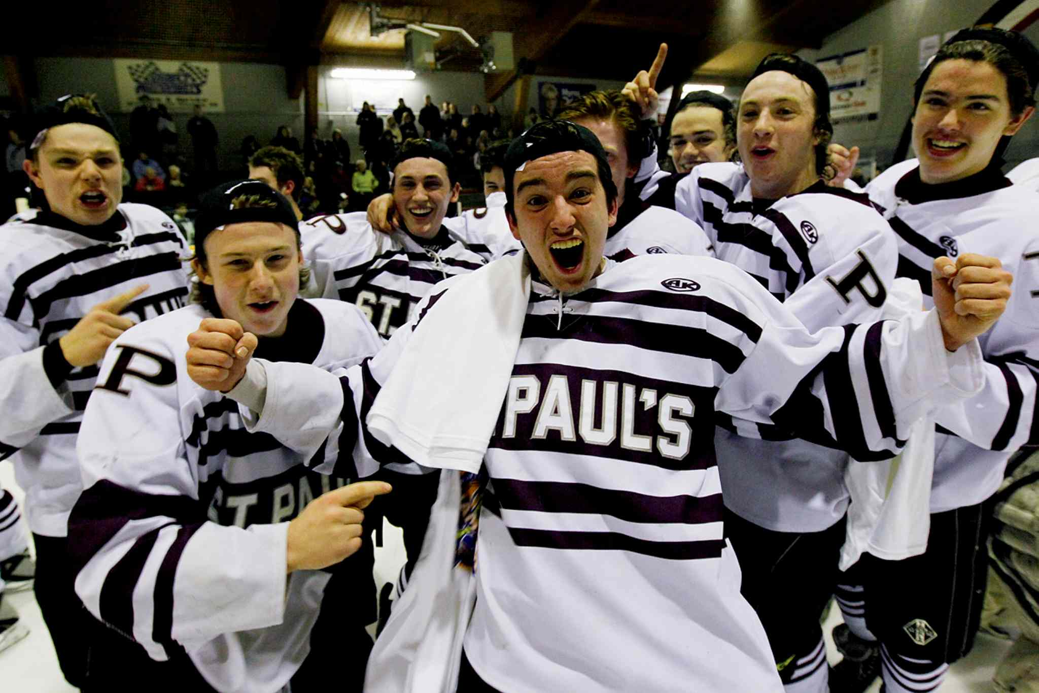 Members of the St. Paul's Crusaders celebrate a win over the Kelvin Clippers in the 2012 Provincial AAAA Boys' High School Hockey Championship. The Crusaders had a disappointing finish in last year's championship run, being knocked out in the quarterfinal, but have fought hard to take the top spot at the AAAA level. They hold a 13-0 record in the Winnipeg High School Hockey League's Platinum Promotions Division.