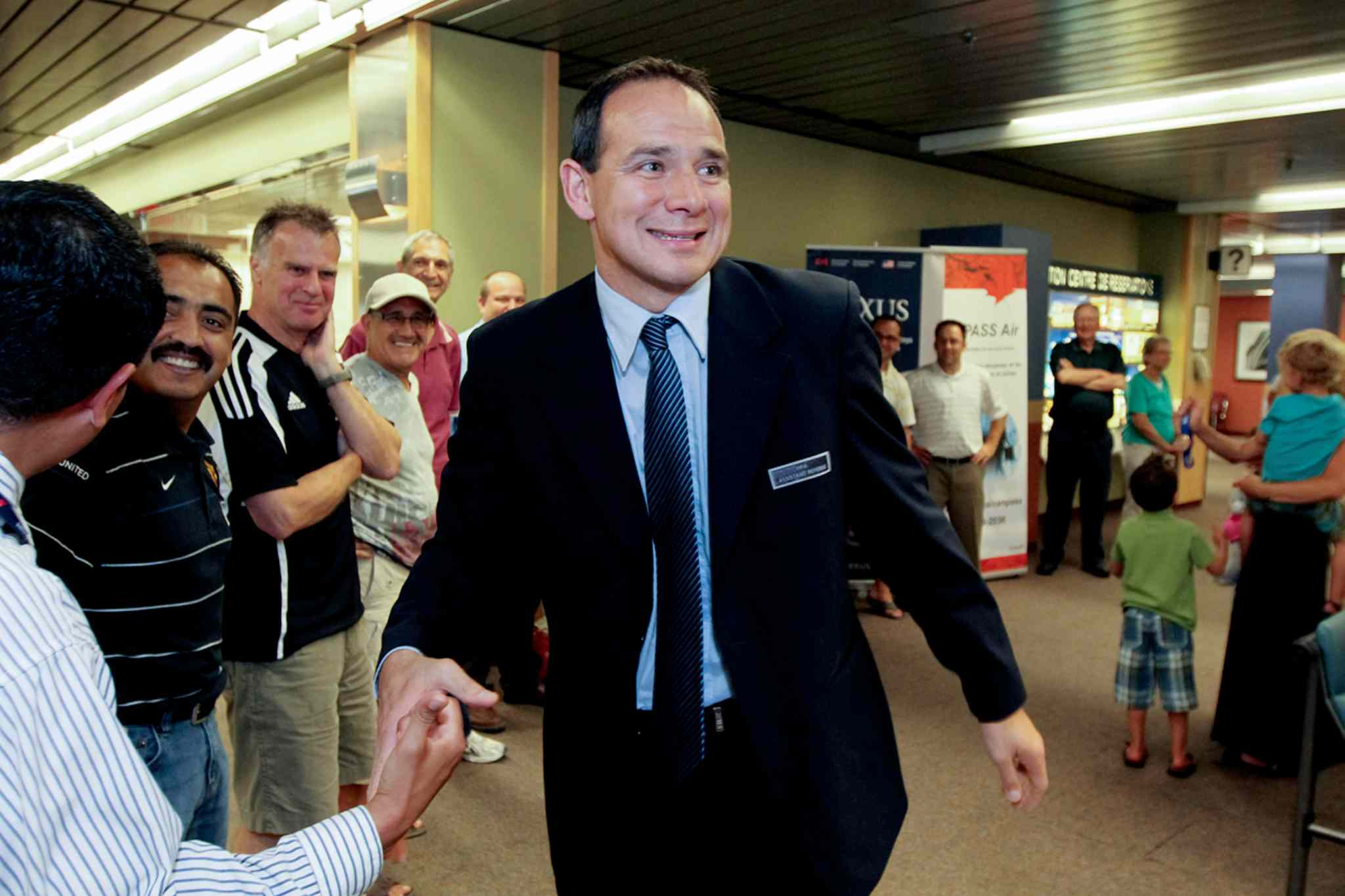In this file photo, Hector Vergara arrives home to applause from family and friends following his return from the FIFA World Cup in 2010. Vergara had been officiating in South Africa as an assistant referee. It was his third and final World Cup.