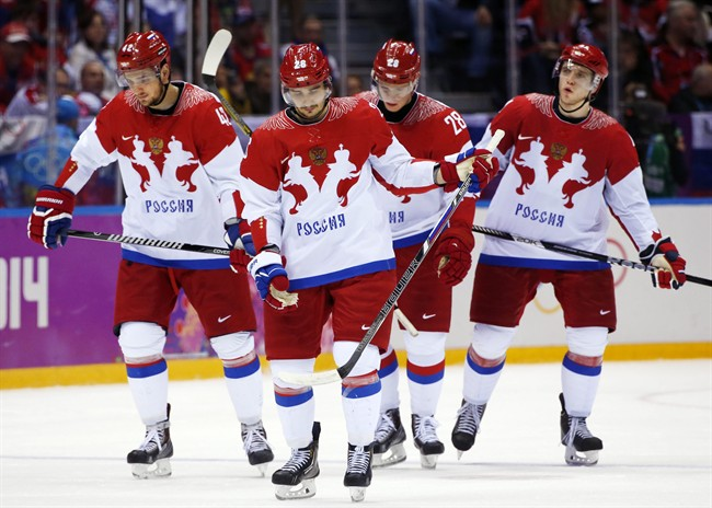 Team Russia skates back on the ice after a break in the third period of a men's quarterfinal ice hockey game against Finland at the 2014 Winter Olympics, Wednesday, Feb. 19, 2014, in Sochi, Russia. (AP Photo/Julio Cortez)