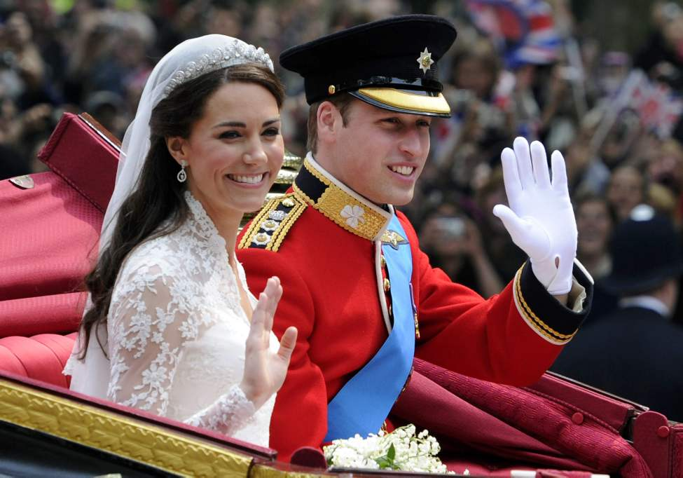 Britain's Prince William and his bride Kate, Duchess of Cambridge, leave Westminster Abbey, London, following their wedding, Friday April 29, 2011. (AP Photo/Tom Hevezi)