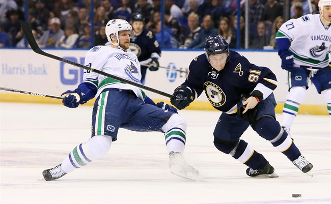 St. Louis Blues right wing Vladimir Tarasenko, right, gets past Vancouver Canucks defenseman Alexander Edler in first period NHL hockey action on Monday, March 30, 2015, at the Scottrade Center in St. Louis. T.J. Oshie believes information overload preparing for the playoffs could be the reason for the Blues' late-season skid. (AP Photo/St. Louis Post-Dispatch, Chris Lee) EDWARDSVILLE INTELLIGENCER OUT; THE ALTON TELEGRAPH OUT; MANDATORY CREDIT