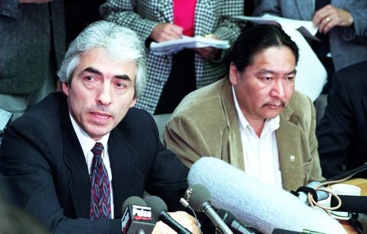 June 18, 1990: Phil Fontaine (left) and Elijah Harper (right) at a meeting with chiefs and federal negotiator Jack London in Winnipeg.