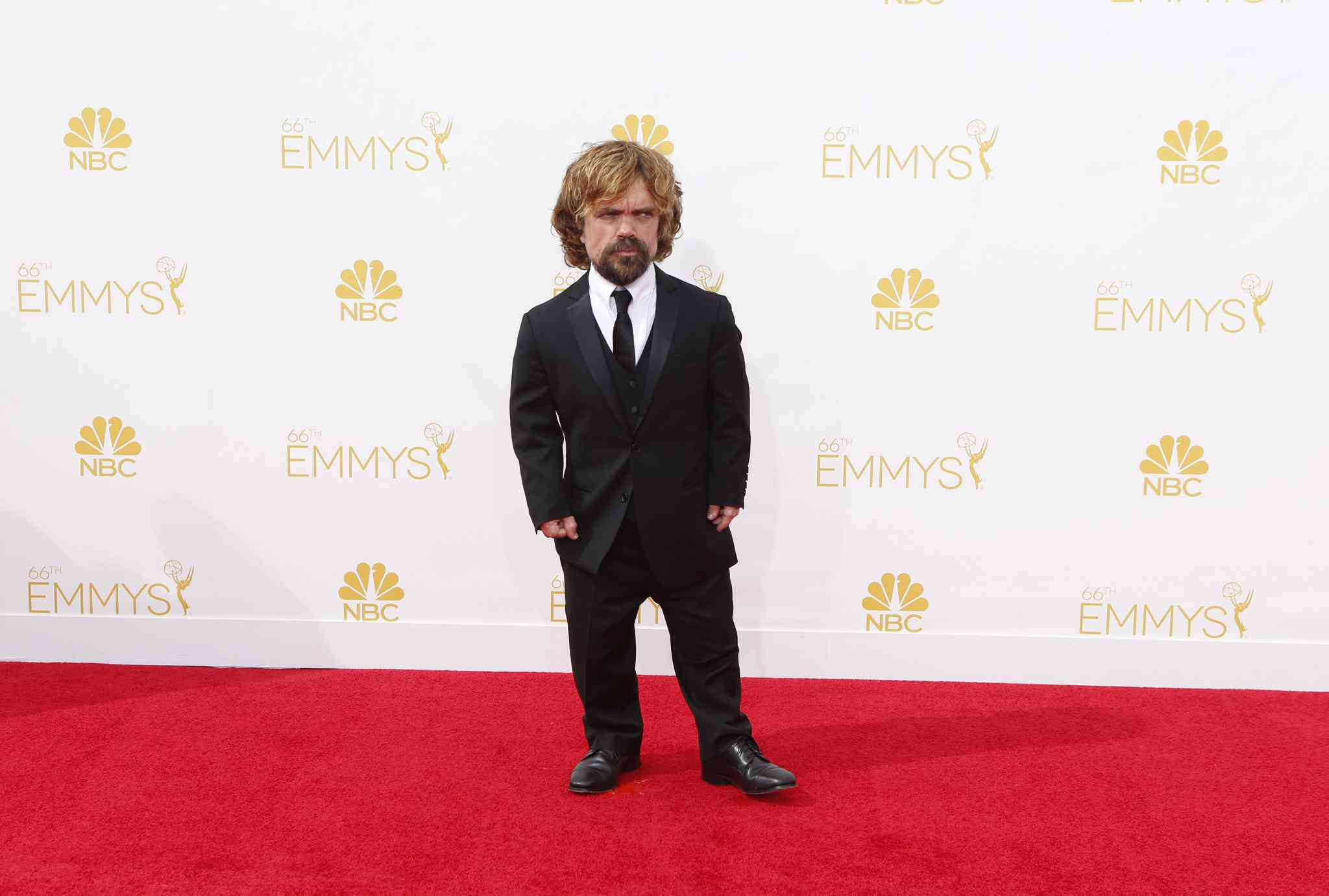Peter Dinklage (Game of Thrones) arrives for the 66th Annual Primetime Emmy Awards at Nokia Theatre at L.A. Live in Los Angeles.