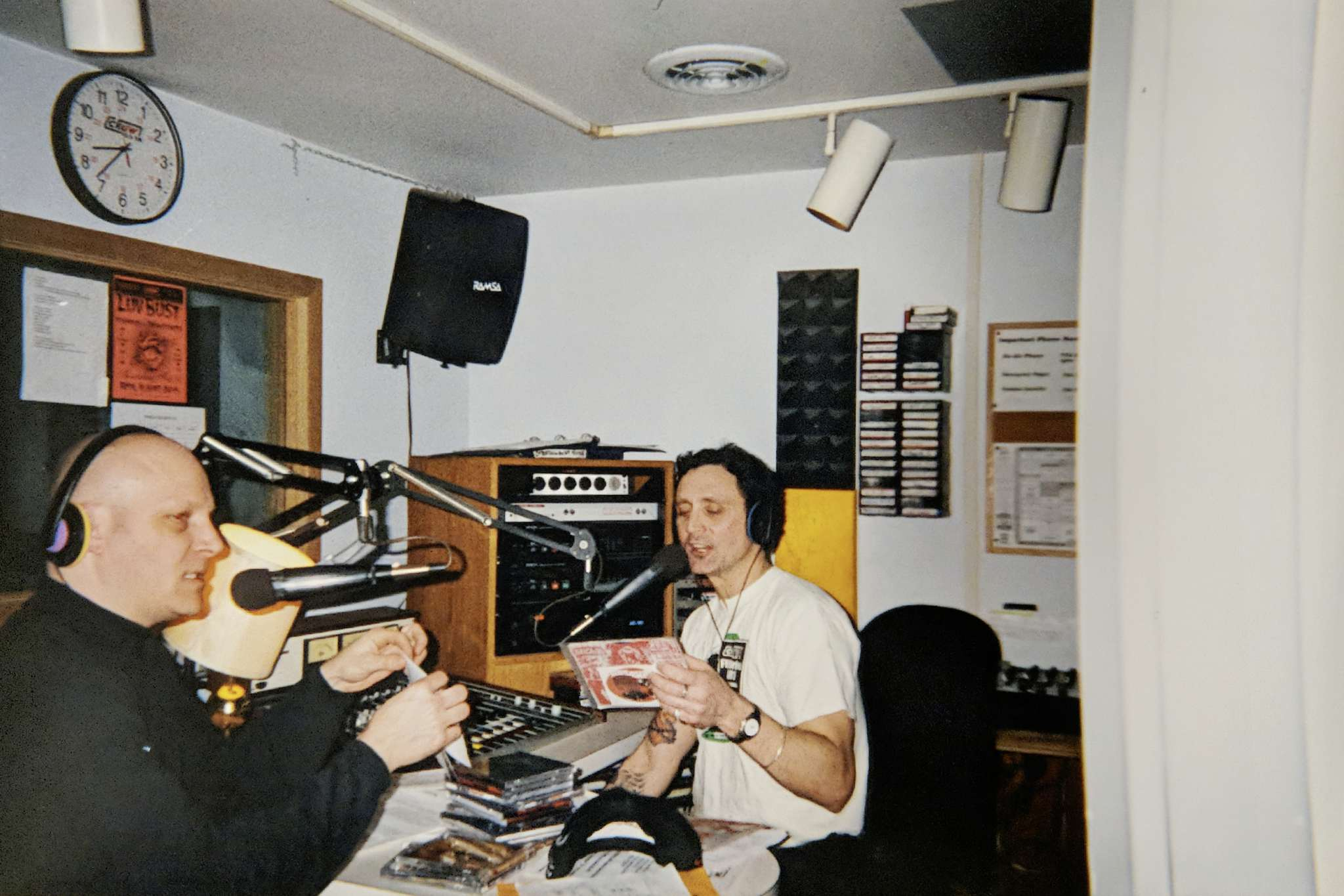CKUW 95.9 FM volunteers Colin Bryce and Jeff Monk on air during the station's 2002 Fundrive fundraiser.