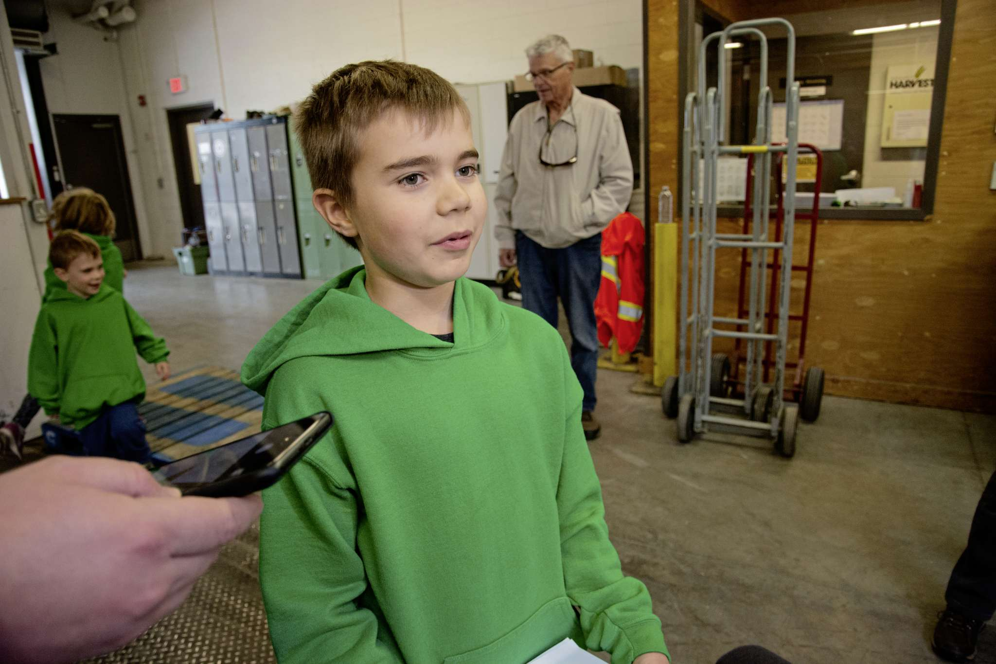 Maxwell Oliver speaks to media after dropping off 1,033 cans at Winnipeg Harvest on Oct. 2. He and his siblings collected the donations during their Cast-A-Can charity poll.