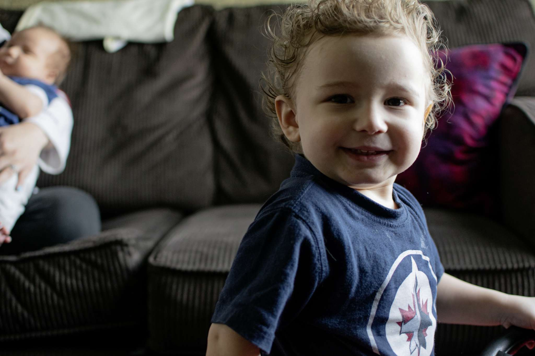 Two-year-old Xavier Traverse smiles at the camera.