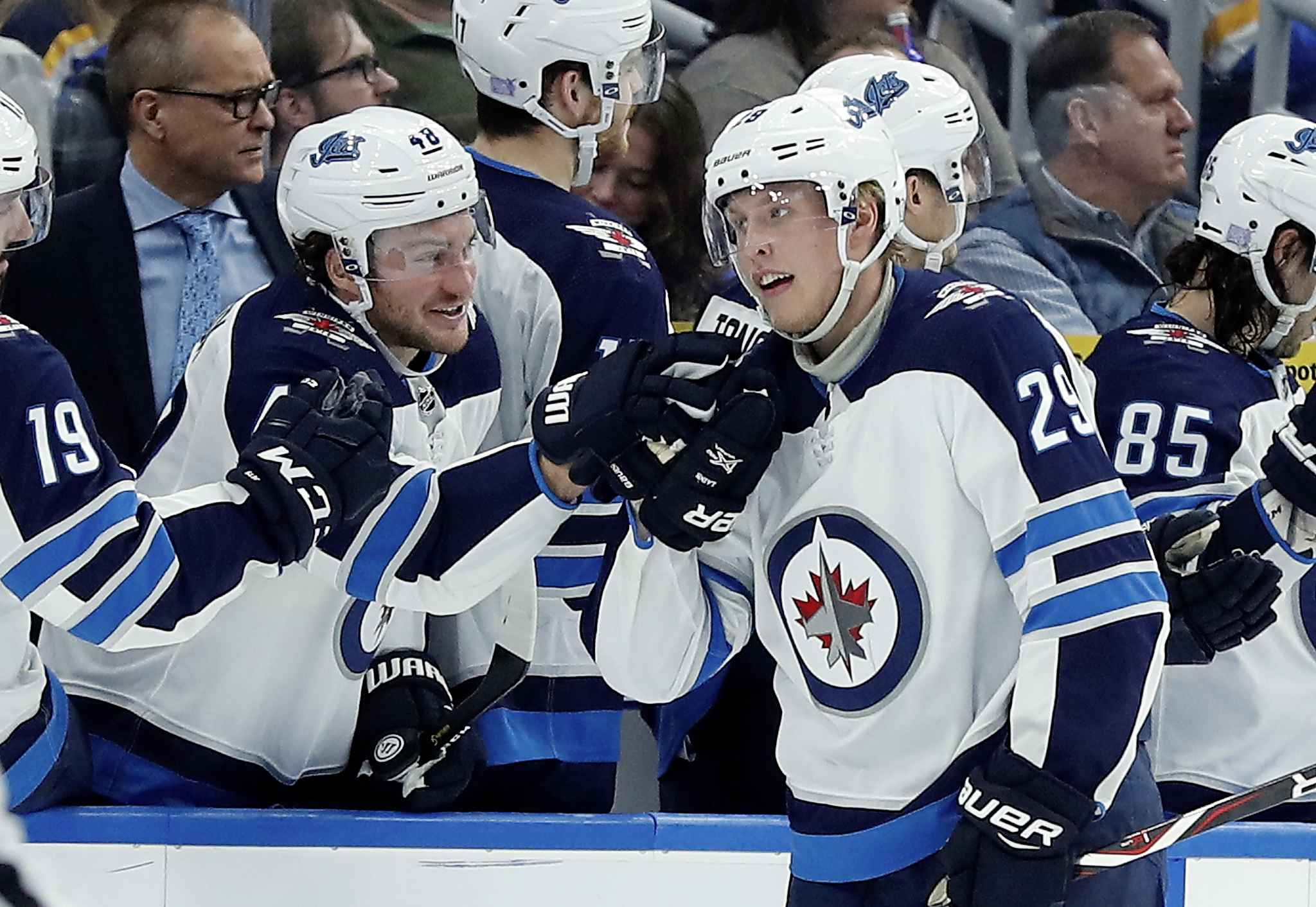historic five-goal night from laine lifts jets to 8-4 win over blues
