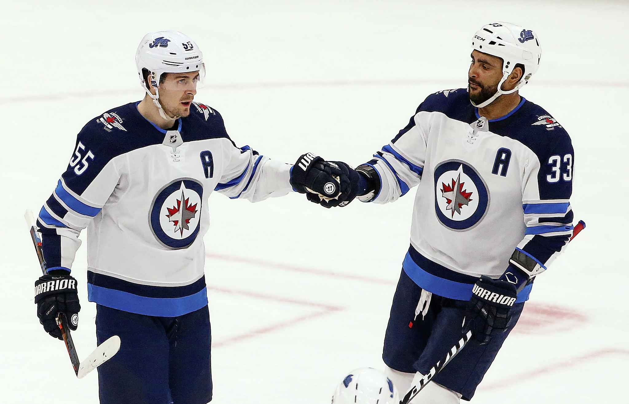 Winnipeg Jets centre Mark Scheifele (55) celebrates his goal against the Arizona Coyotes with defenceman Dustin Byfuglien (33) during the first period of an NHL hockey game Saturday, April 6, 2019, in Glendale, Ariz. (AP Photo/Ross D. Franklin)