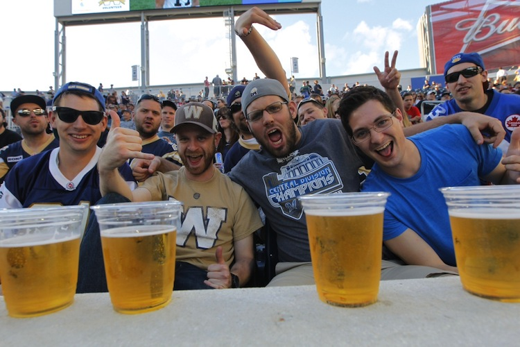 Winnipeg Blue Bomber fans enjoy the game and some cold beers Wednesday night at Investors Group Field. (Boris Minkevich / Winnipeg Free Press)