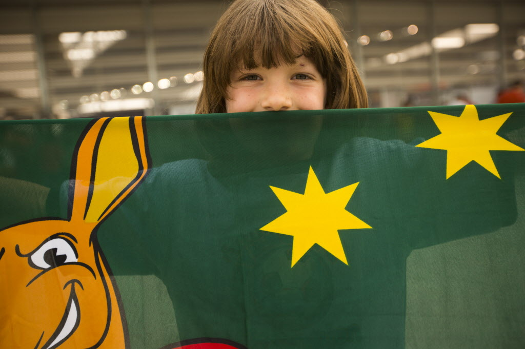 Spencer Merlino, 6, holds up his Australian banner before going into the stadium at the FIFA World Cup United States vs. Australia game at the Investors Group Field on Monday. Spencer was born in Sydney, Australia, and now lives in Kenora.  (Mikaela MacKenzie / Winnipeg Free Press)