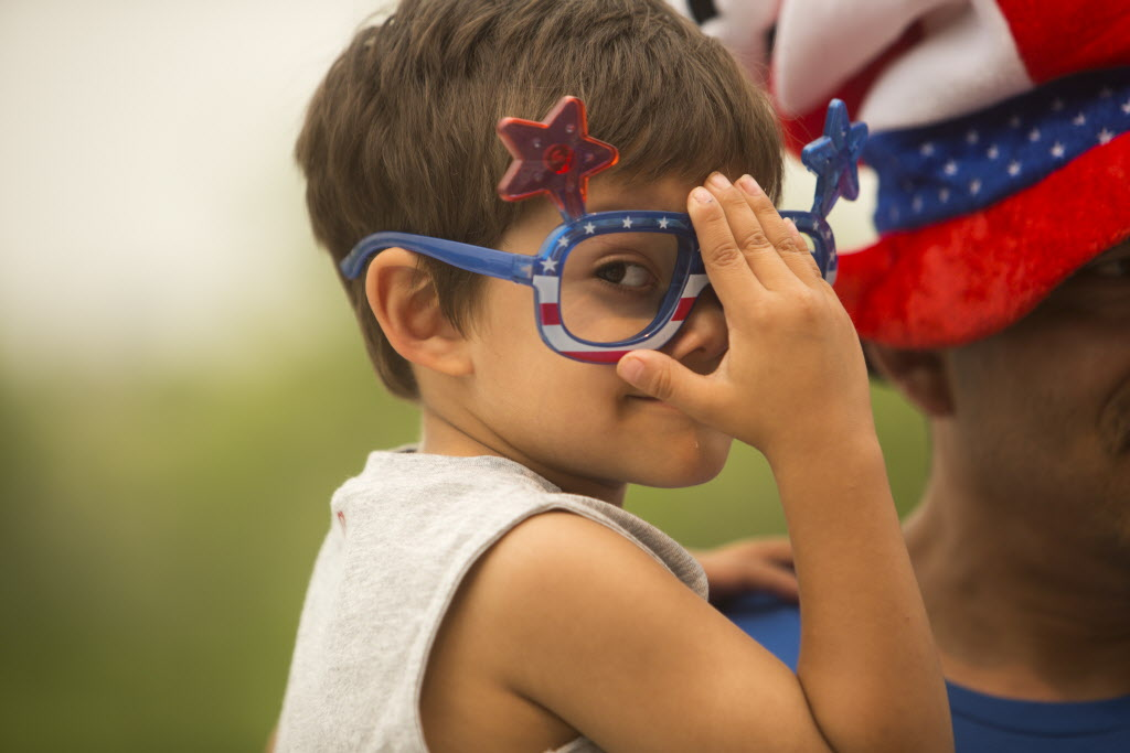 Little fan Ryan Rodriguez, 4, adjusts his glasses while waiting in line to see the Nigeria vs. Sweden game at the Investors Group Field on Monday. (Mikaela MacKenzie / Winnipeg Free Press)