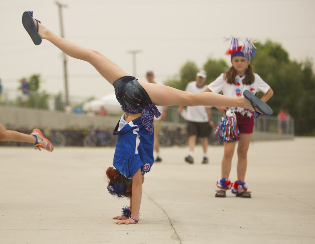 Heather Shearman, 11, does handstands before going in to see the Nigeria vs. Sweden game at the Investors Group Field on Monday. (Mikaela MacKenzie / Winnipeg Free Press)