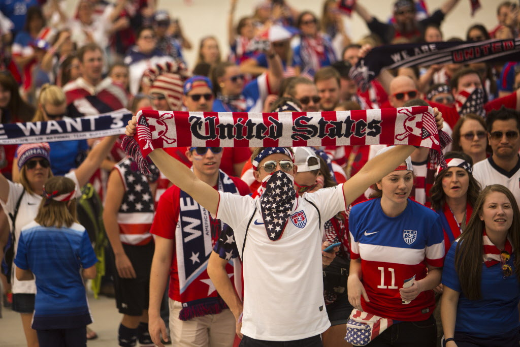 Members of the soccer fan group the American Outlaws march up to the stadium to see the FIFA World Cup United States vs. Australia game at the Investors Group Field on Monday. (Mikaela MacKenzie / Winnipeg Free Press)