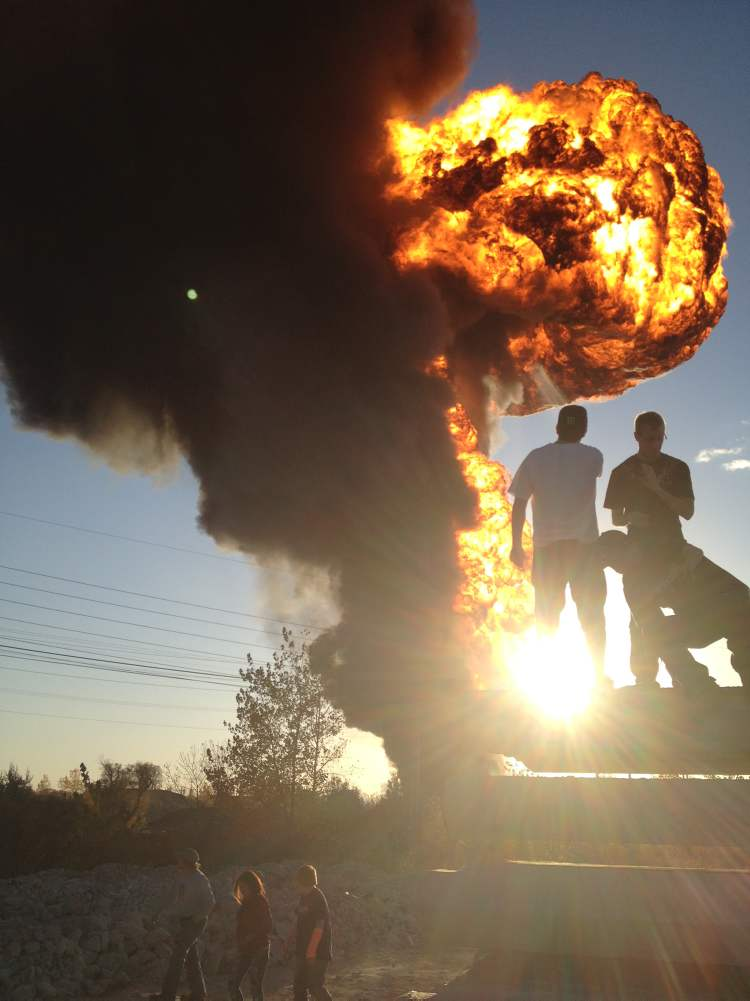 A massive fireball goes up from a blaze at Speedway International, northeast of Archibald and Marion in St. Boniface. Witnesses reported an explosion that shook the ground and firefighters issued an order for everyone, including fire crews, to move back.  (Boris Minkevich / Winnipeg Free Press)