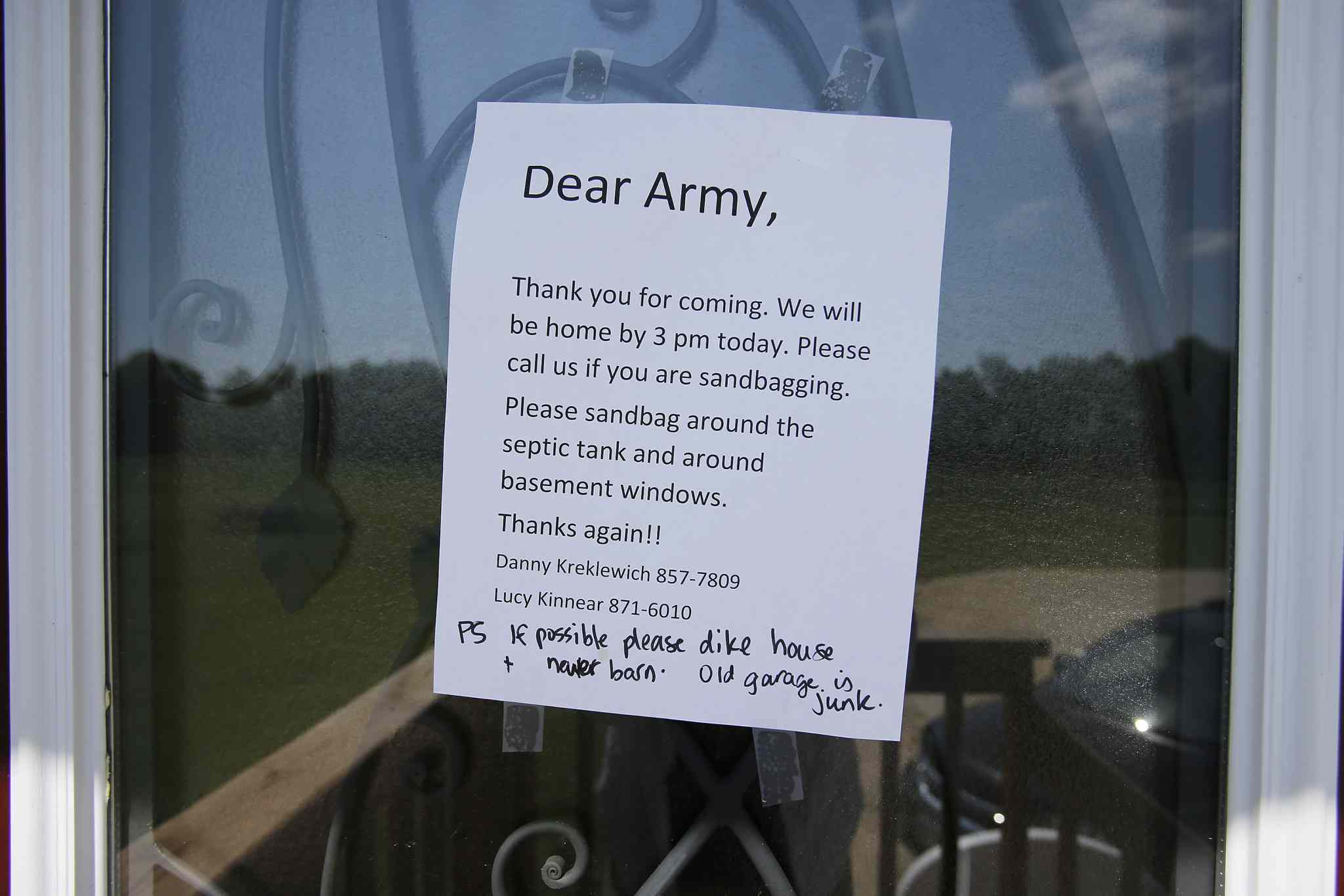 A sign taped to a door just south of the Hoop and Holler Bend, Man. welcomes the military Saturday.