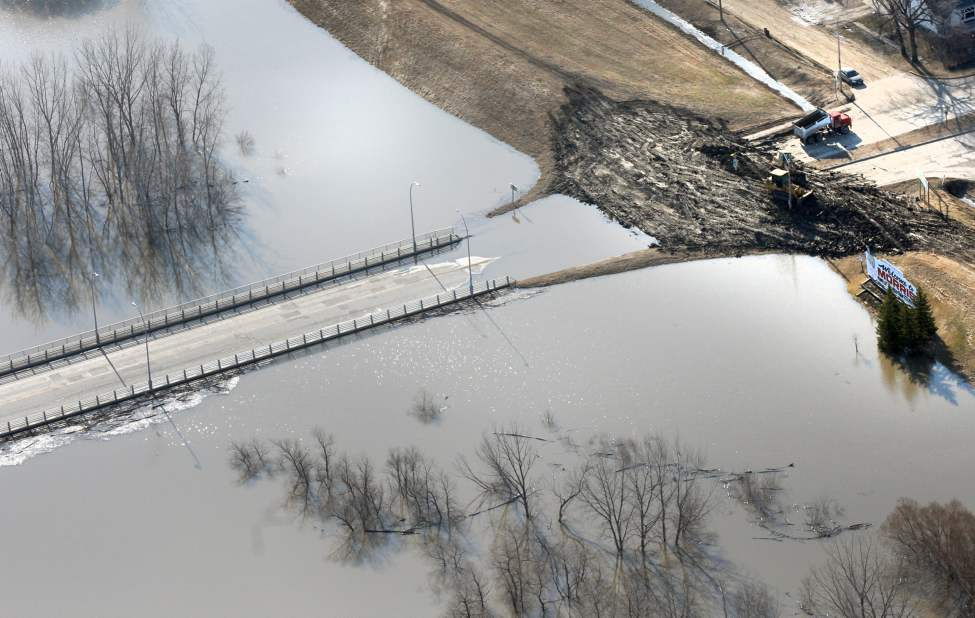 Highway 75, the main highway from Winnipeg,  is closed because of the flooding Morris River and Red River at Morris.