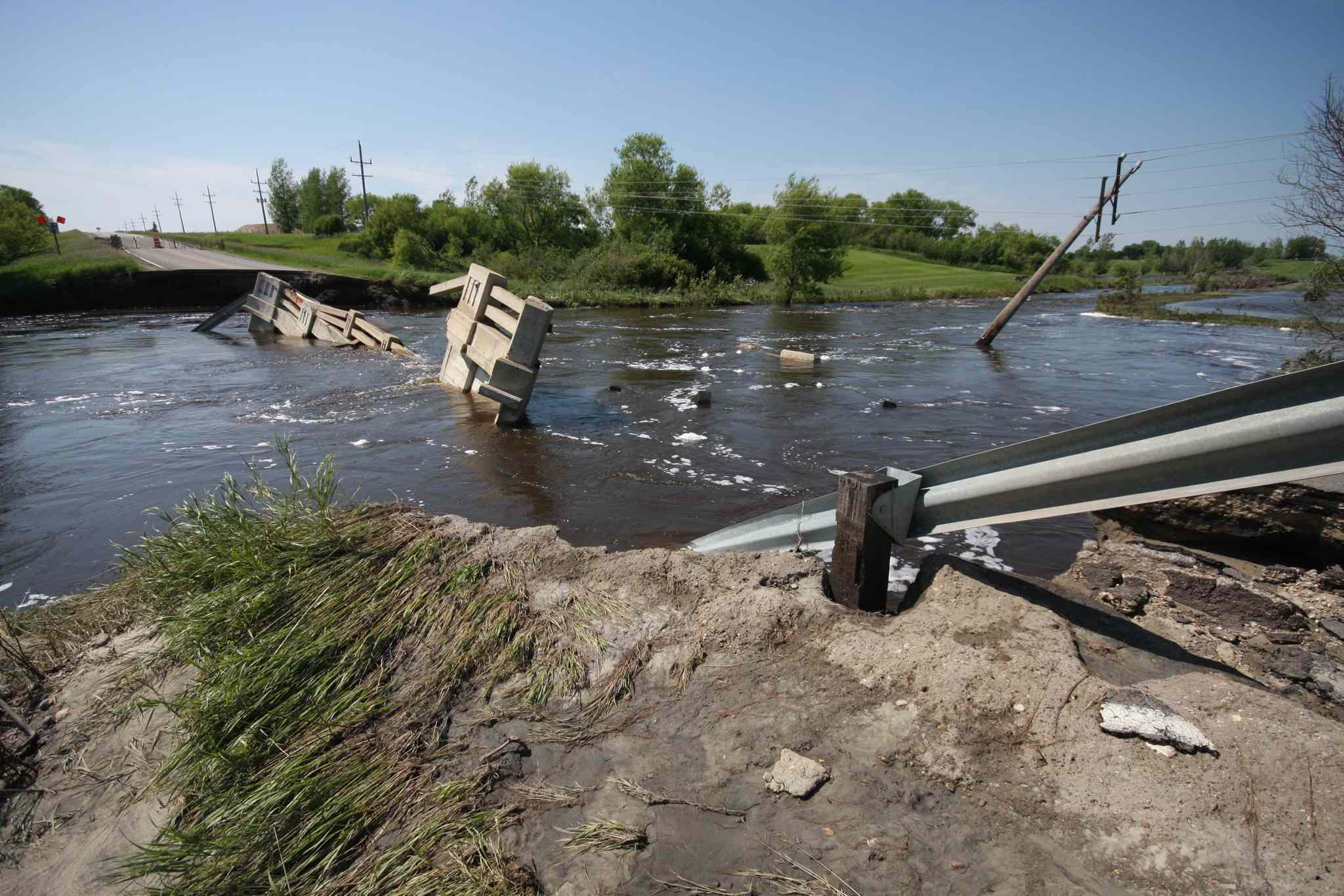 A bridge was completely washed away after this week's flooding on Highway 445 in Melita.