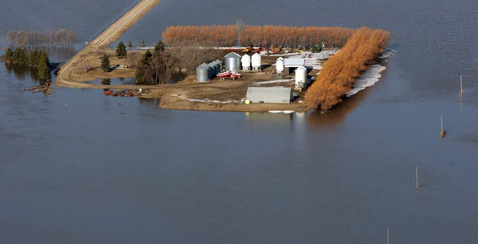 Farmers properties are surrounded by the flooded Red River near the town of St Jean Baptiste Wednesday morning.