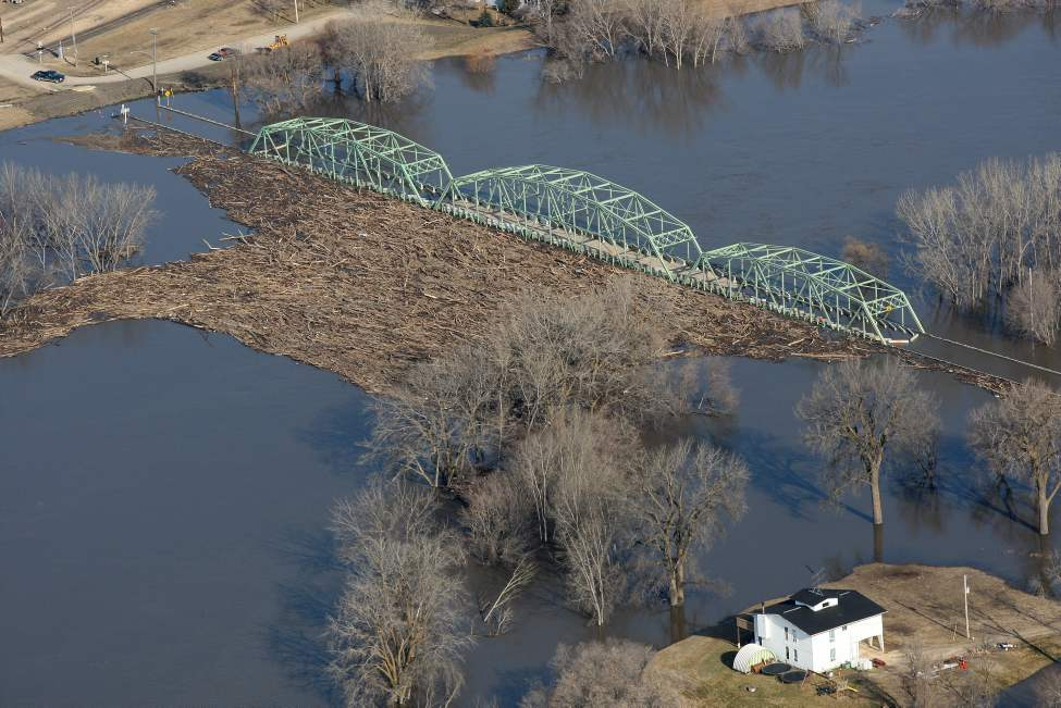 The bridge is closed at St John Baptiste because of high flood waters from the Red River. Debris wood piles near the bridge Wednesday morning.