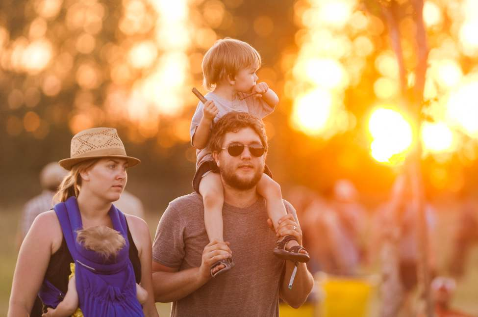 Stacey Waldron (left) travels between stages with her husband Dan and kids Janae, 6 months, and Alex, 2, at the 2012 Winnipeg Folk Festival on Saturday. Melissa Tait / Winnipeg Free Press
