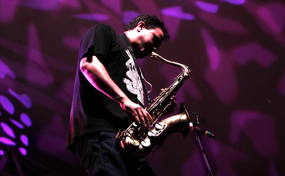 Ulises Bella, saxophone player with Ozomatli  performs on the Main Stage with his band at the 39th annual Winnipeg Folk Festival at Birds Hill Park Thursday night. Ruth Bonneville / Winnipeg Free Press