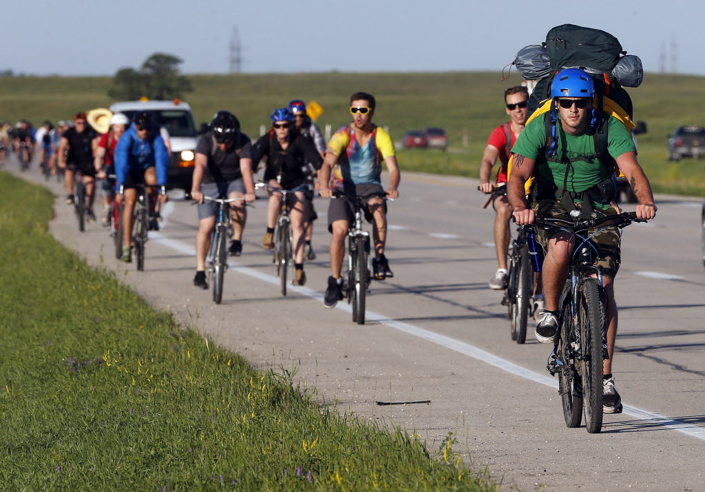 The day began with the bike ride to the park, hundreds of participants  rode their bikes to the Birds Hill Park to get priority entry to the Winnipeg Folk Festival on Wednesday. (KEN GIGLIOTTI / WINNIPEG FREE PRESS)