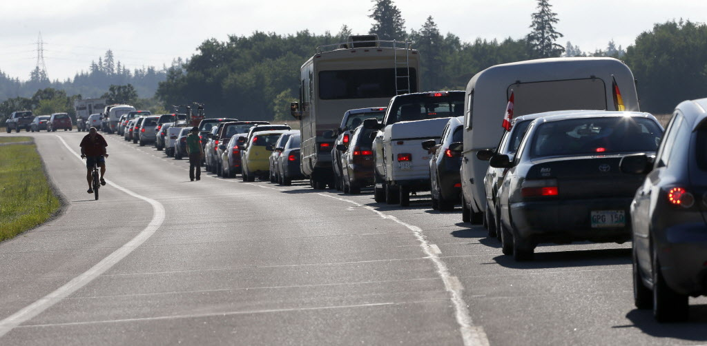 Folk lovers began their Wednesday, July 9 with a drive or bike ride to Birds Hill Park to get priority entry to the Winnipeg Folk Festival. Thousands of cars , trucks and RVs rolled directly into the park toward campground parking in a streamlined process free of  previous years' delays.