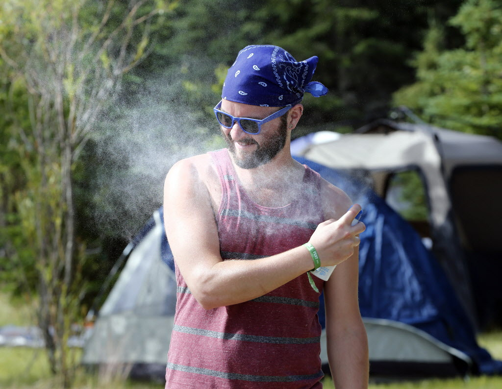 Bring your bug spray and sunscreen: Thomas Beever has both in preparation for the Folk Festival's start.  (KEN GIGLIOTTI / WINNIPEG FREE PRESS)