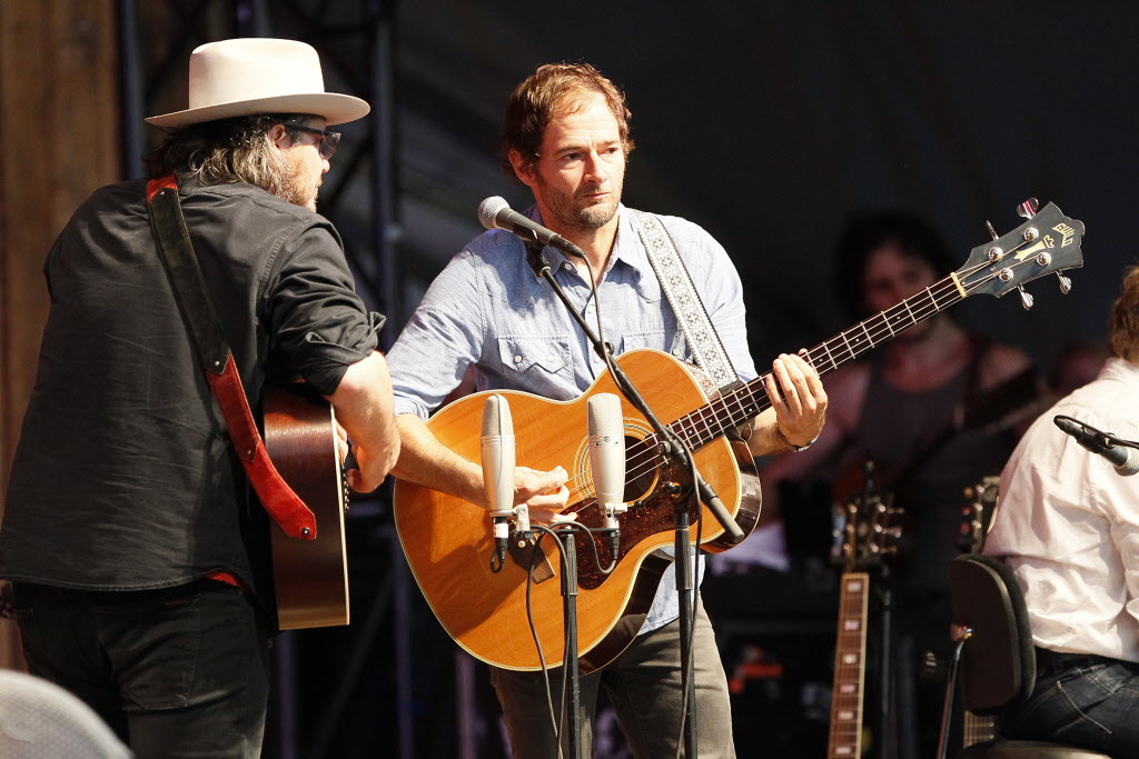 Wilco begins to perform at the Winnipeg Folk Fest Sunday, before the headliners were forced to cancel their show because of rain. (John Woods / Winnipeg Free Press)