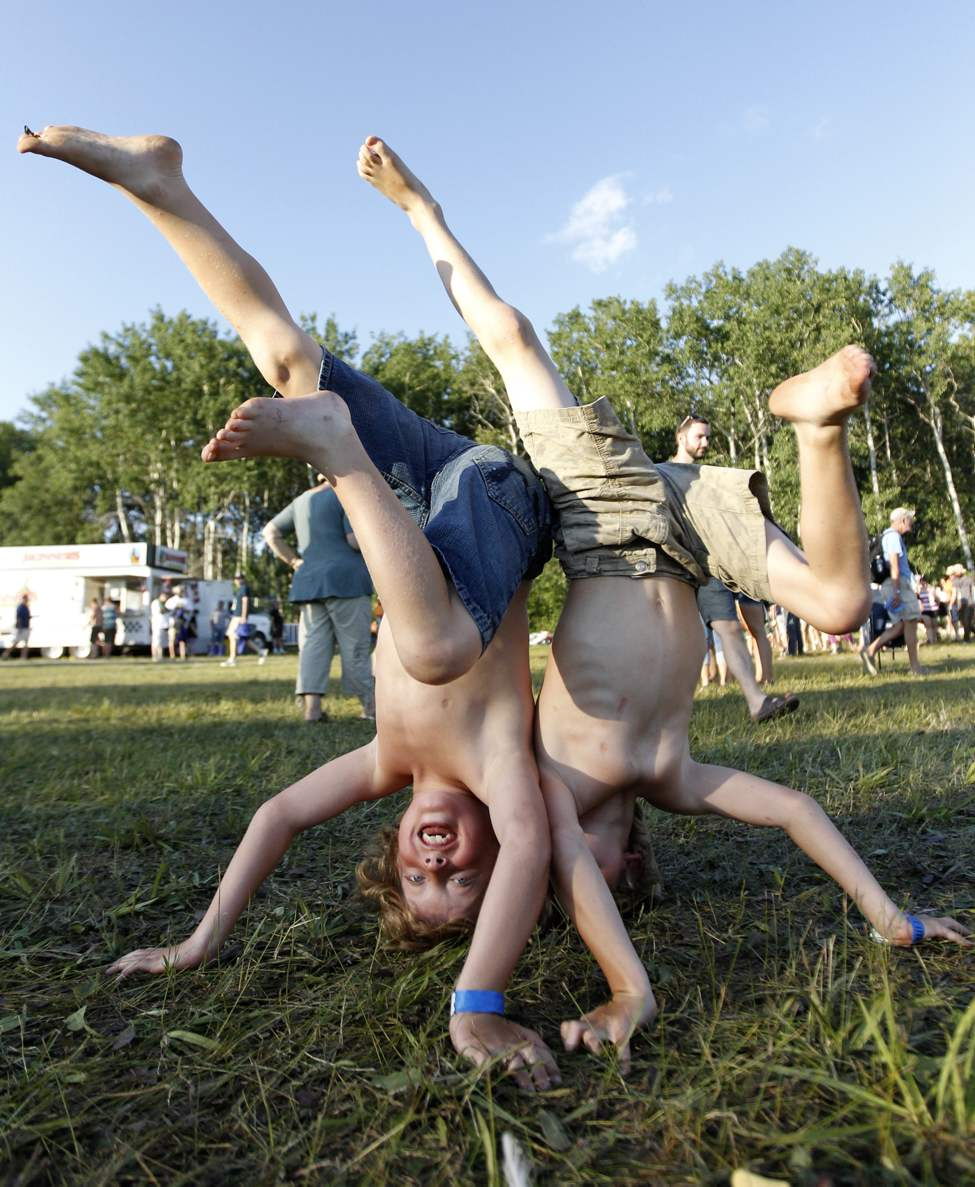 Twin eight-year-old brothers Ethan and Kieran Wiebe practice their hand stands prior to Beth Orton performing at the Winnipeg Folk Festival at Birds Hill Park on Friday, July 6, 2012. (TREVOR HAGAN / WINNIPEG FREE PRESS)