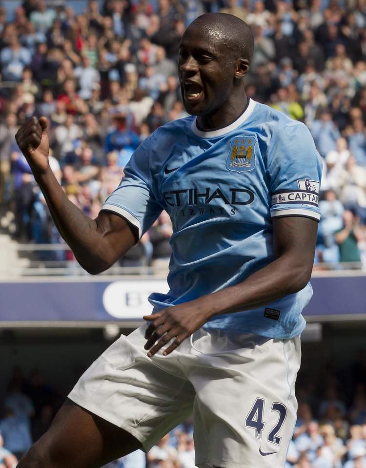 Manchester City's Yaya Toure celebrates after scoring against Hull during Man City's 2-0 victory in English Premier League soccer action in Manchester, Saturday.