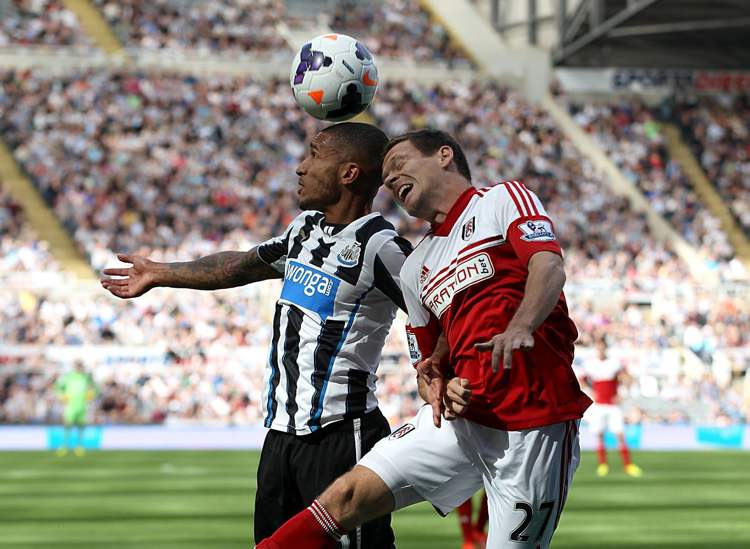Fulham's Sascha Riether (right) and Newcastle United's Sylvain Marveaux challenge for a header during their English Premier League in Newcastle, Saturday. The hometown Geordies topped the Cottagers 1-0.