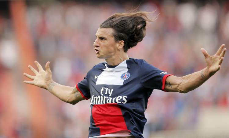 Paris Saint Germain's Zlatan Ibrahimovic celebrates after scoring against Guingamp during PSG's 2-0 victory French League One soccer in Paris, Saturday. (CP)
