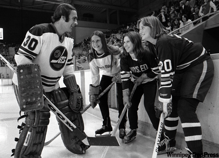 Jets backup goalie Curt Larsons does between-period promo in October 1976 with University of Manitoba  women hockey players.