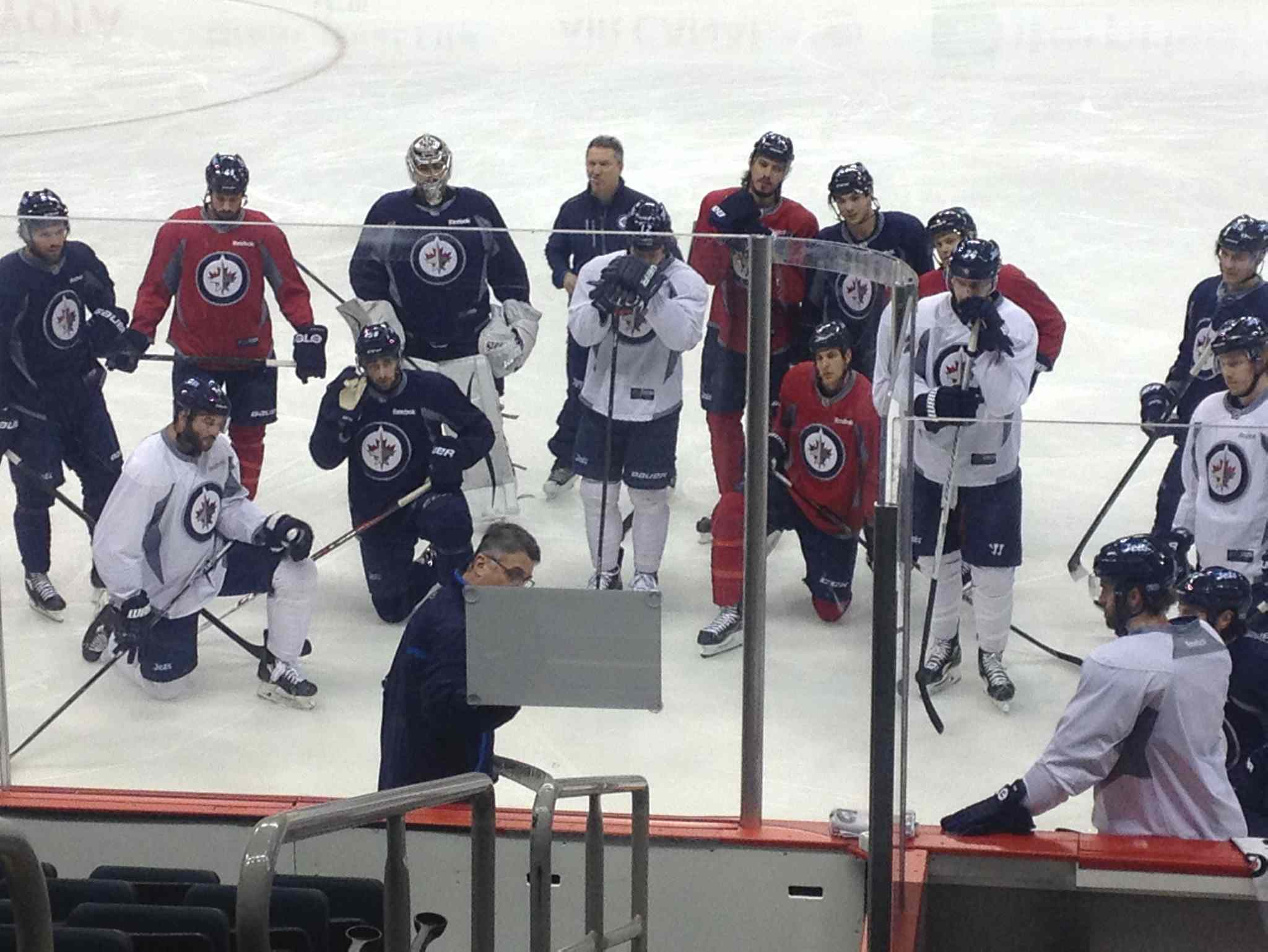 Winnipeg Jets watch as coach Claude Noel draws up a game plan at practice at the MTS Centre Friday morning.  The Jets, now last in the NHL's Central Division at 19-22-5, next play Saturday at home against Columbus.