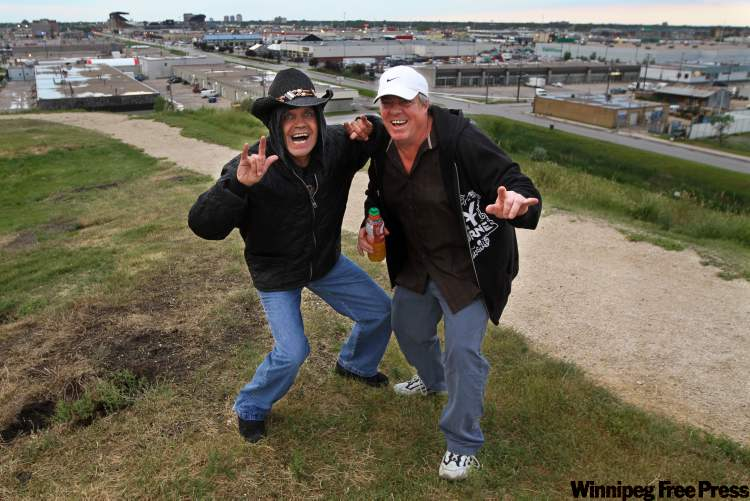 Larry Z. (left) and Ken F. were two of the rockers who clambered up Garbage Hill for a long-distance view of the Bon Jovi concert at Canad Inns Stadium Saturday night.